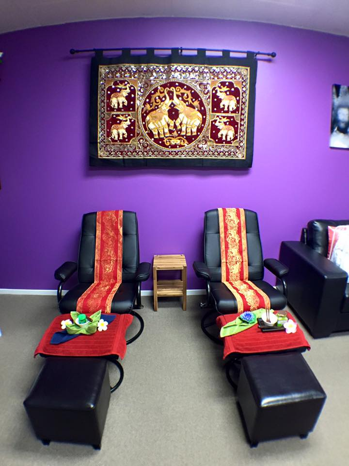 Two comfortable chairs and two stools setup ready for foot massage inside Sawaddee