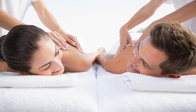 A couple receiving a couples massage together